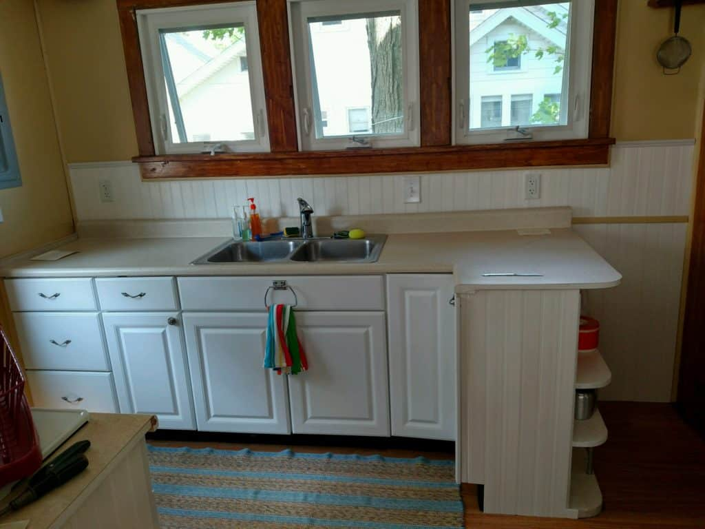 Adding PVC beadboard to a kitchen backsplash adds a cottage look and is perfect for a wet area