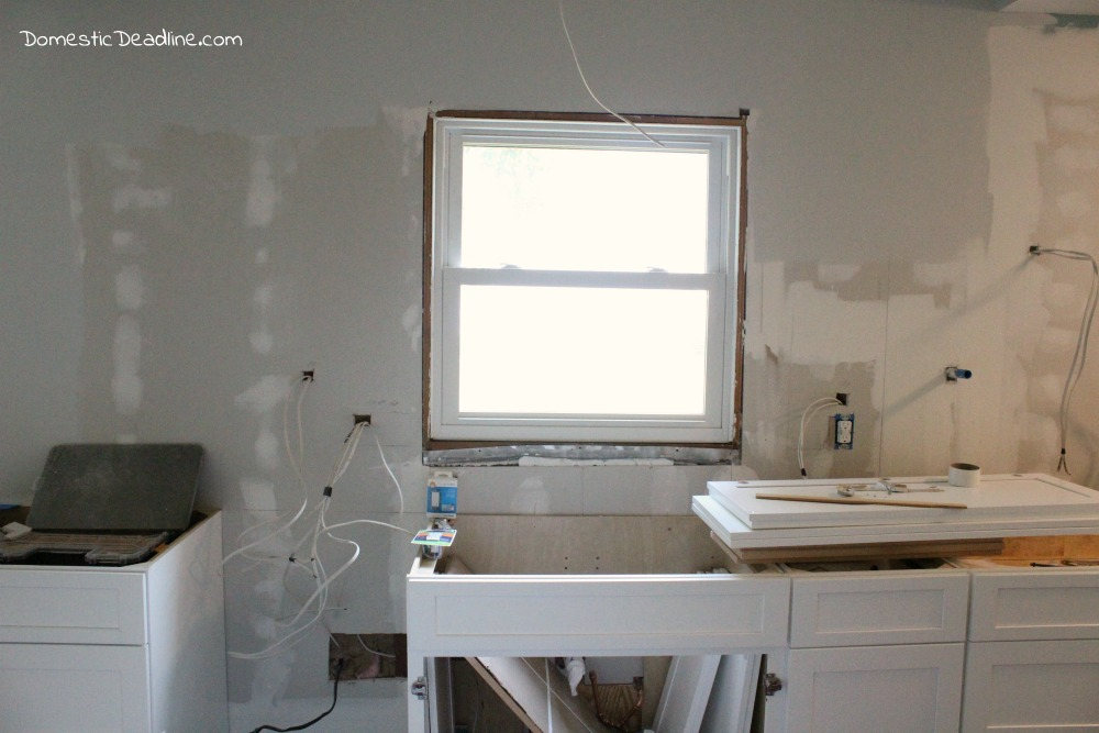 Installing Kitchen Cabinets in our DIY Kitchen - Domestic Deadline