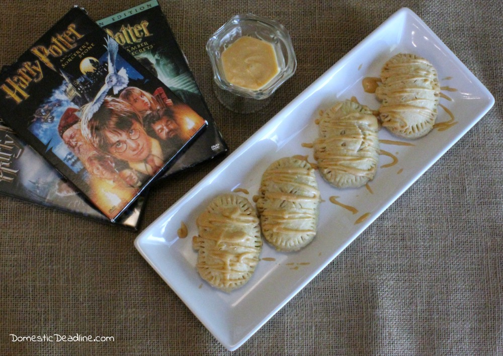 Pumpkin filling in a flaky gluten-free crust drizzled with a butterbeer frosting makes the perfect treat for a Harry Potter movie marathon. Pumpkin Pasties - Domestic Deadline