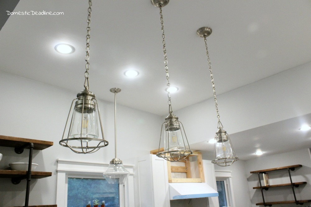 industrial farmhouse lighting. the pendant lights are pulling my fixer upper kitchen together combining brushed nickel and glass industrial farmhouse lighting