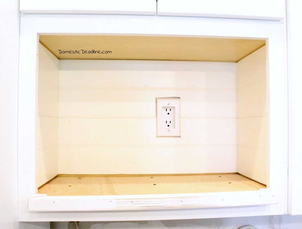 With champagne taste on a beer budget, I customized some of my kitchen cabinets to save money. See my budget-friendly solution for a small microwave. - Domestic Deadline
