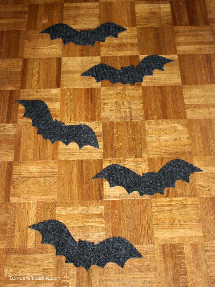 Try this simple dollar store craft using doormats! Easily turn them into bat walkway mats for festive Halloween decor. Quick, fun, and cheap! Domestic Deadline