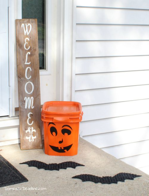 Upcycle an old kitty litter bucket into a fun and festive Halloween decoration, and use it for storage of decorations the rest of the year! - Domestic Deadline