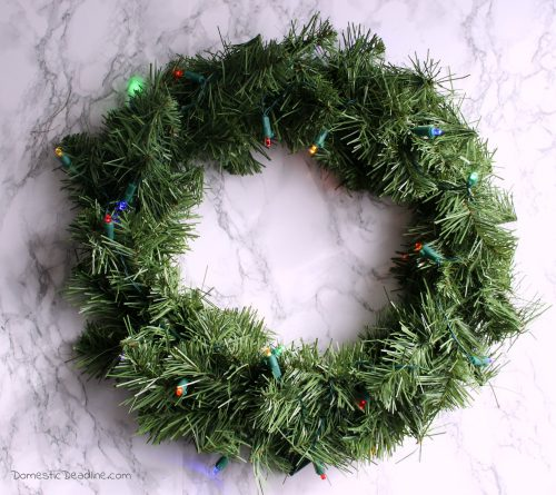 Multiple light up wreaths with battery operated timers to add a festive glow. The 12 Days of Christmas Blog Hop provides even more ideas. - Domestic Deadline
