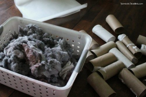 These easy DIY fire starters with dryer lint and toilet paper tubes are a great way to use things that would otherwise go in the trash. Wrapped in wax paper to ignite the fire